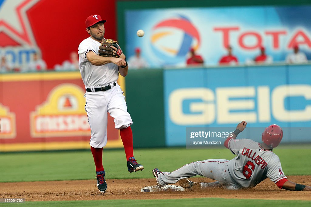 <a gi-track='captionPersonalityLinkClicked' href=/galleries/search?phrase=Alberto+Callaspo&family=editorial&specificpeople=835933 ng-click='$event.stopPropagation()'>Alberto Callaspo</a> #6 of the Los Angeles Angels of Anaheim is force out at 2nd as <a gi-track='captionPersonalityLinkClicked' href=/galleries/search?phrase=Ian+Kinsler&family=editorial&specificpeople=538104 ng-click='$event.stopPropagation()'>Ian Kinsler</a> #5 of the Texas Rangers makes the turn to 1st on July 30, 2013 at the Rangers Ballpark in Arlington in Arlington, Texas.