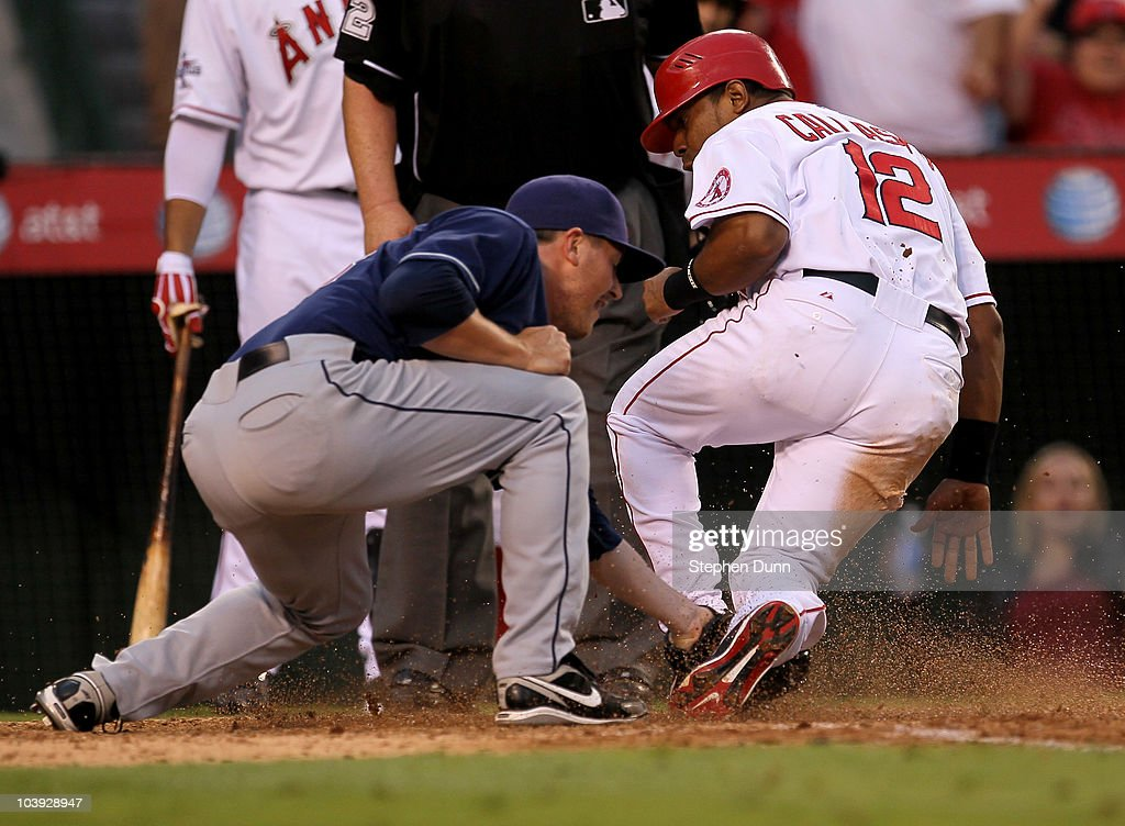 <a gi-track='captionPersonalityLinkClicked' href=/galleries/search?phrase=Alberto+Callaspo&family=editorial&specificpeople=835933 ng-click='$event.stopPropagation()'>Alberto Callaspo</a> #12 of the Los Angeles Angels of Anaheim is tagged out by pitcher Joe Smith #38 of of the Cleveland Indians to end the ninth inning as Callaspo tries to score the winning run from third on a ball that got past the catcher on September 8, 2010 at Angel Stadium in Anaheim, California. The game then went into extra innings.