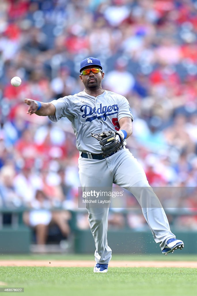 Alberto Callaspo #5 of the Los Angeles Dodgers fields a ground ball during a baseball game against the Washington Nationals at Nationals Park on July 19, 2015 in Washington, DC. The Dodgers won 5-0.