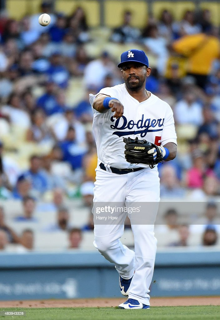Alberto Callaspo #5 of the Los Angeles Dodgers makes a throw to first for an out against the Washington Nationals at Dodger Stadium on August 12, 2015 in Los Angeles, California.