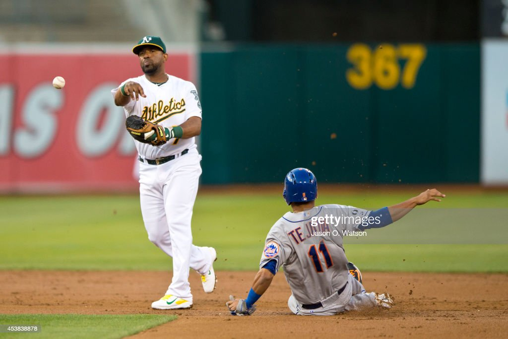 <a gi-track='captionPersonalityLinkClicked' href=/galleries/search?phrase=Alberto+Callaspo&family=editorial&specificpeople=835933 ng-click='$event.stopPropagation()'>Alberto Callaspo</a> #7 of the Oakland Athletics completes a double play around <a gi-track='captionPersonalityLinkClicked' href=/galleries/search?phrase=Ruben+Tejada&family=editorial&specificpeople=5754705 ng-click='$event.stopPropagation()'>Ruben Tejada</a> #11 of the New York Mets during the second inning of an interleague game at O.co Coliseum on August 19, 2014 in Oakland, California.