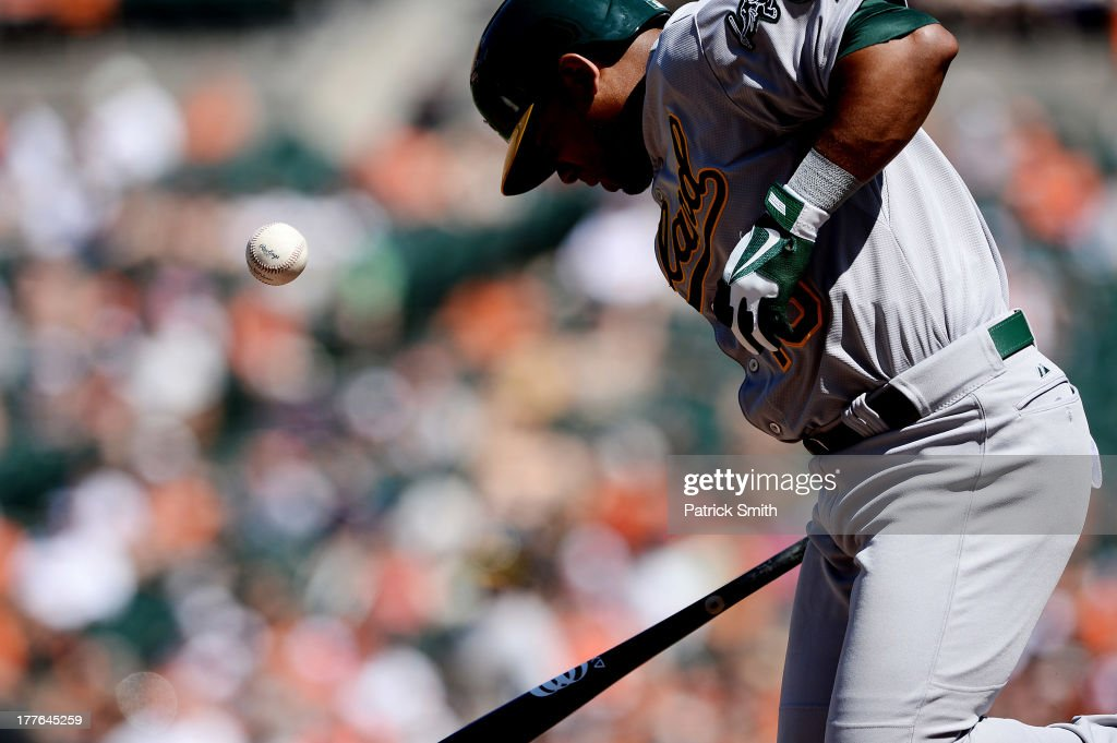 <a gi-track='captionPersonalityLinkClicked' href=/galleries/search?phrase=Alberto+Callaspo&family=editorial&specificpeople=835933 ng-click='$event.stopPropagation()'>Alberto Callaspo</a> #18 of the Oakland Athletics is hit by a pitch against the Baltimore Orioles in the third inning at Oriole Park at Camden Yards on August 25, 2013 in Baltimore, Maryland.