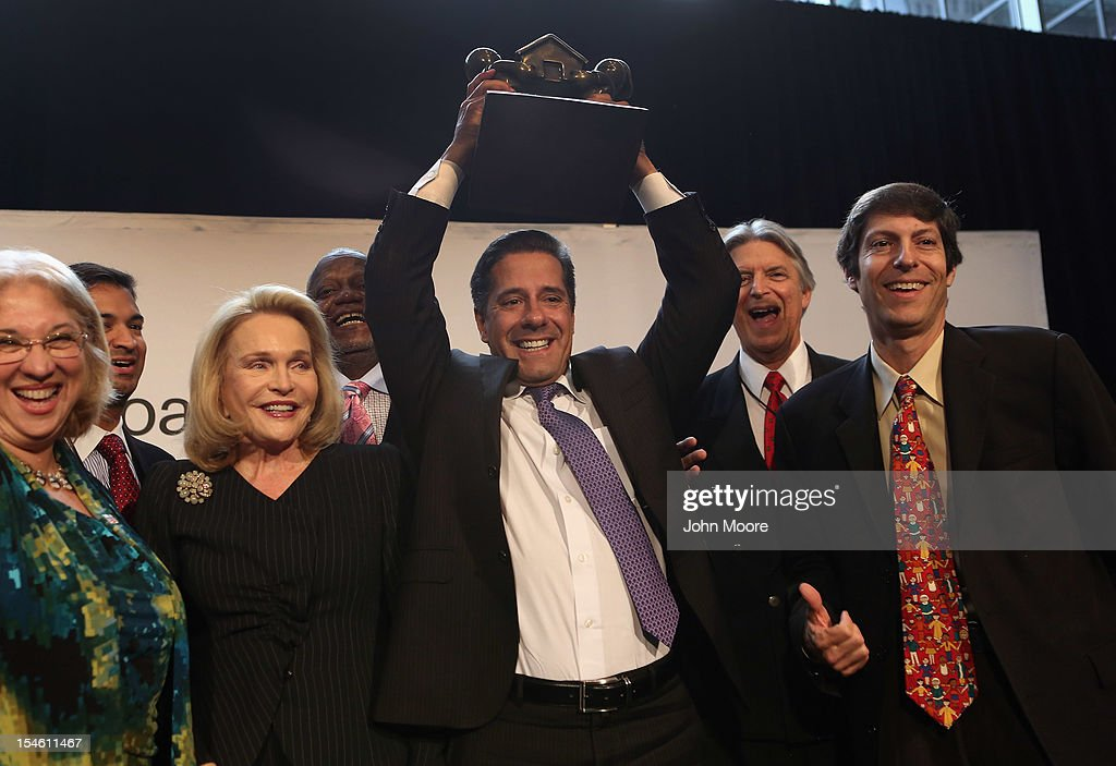 Alberto Carvalho (C), superintendent of the Miami-Dade County Public Schools, celebrates after Miami-Dade won the 2012 Broad Prize for Urban Education on October 23, 2012 in New York City. The award recognizes a large school district making the greatest progress nationwide in raising overall student achievment while reducing achievement gaps in low-income and minority students. Miami-Dade, a five-time finalist, will receive $550,000 in college scholarships for its high school seniors. The three other finalists, Corona Norco, Houston and Palm Beach, each receive $150,000 in scholarships.
