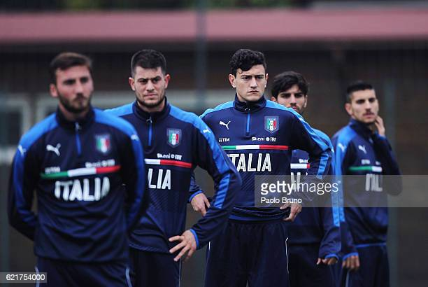Alberto Cerri and Alex Ferrari with their teammates of Italy U21 look on during the Italy U21 training session on November 8 2016 in Rome Italy