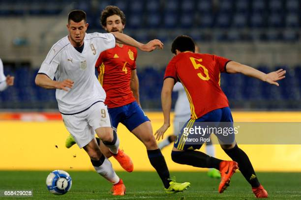 Alberto Cerri of Italy U21 compete for the ball with Jorge Mer of Spain U21 during the international friendly match between Italy U21 and Spain U21...