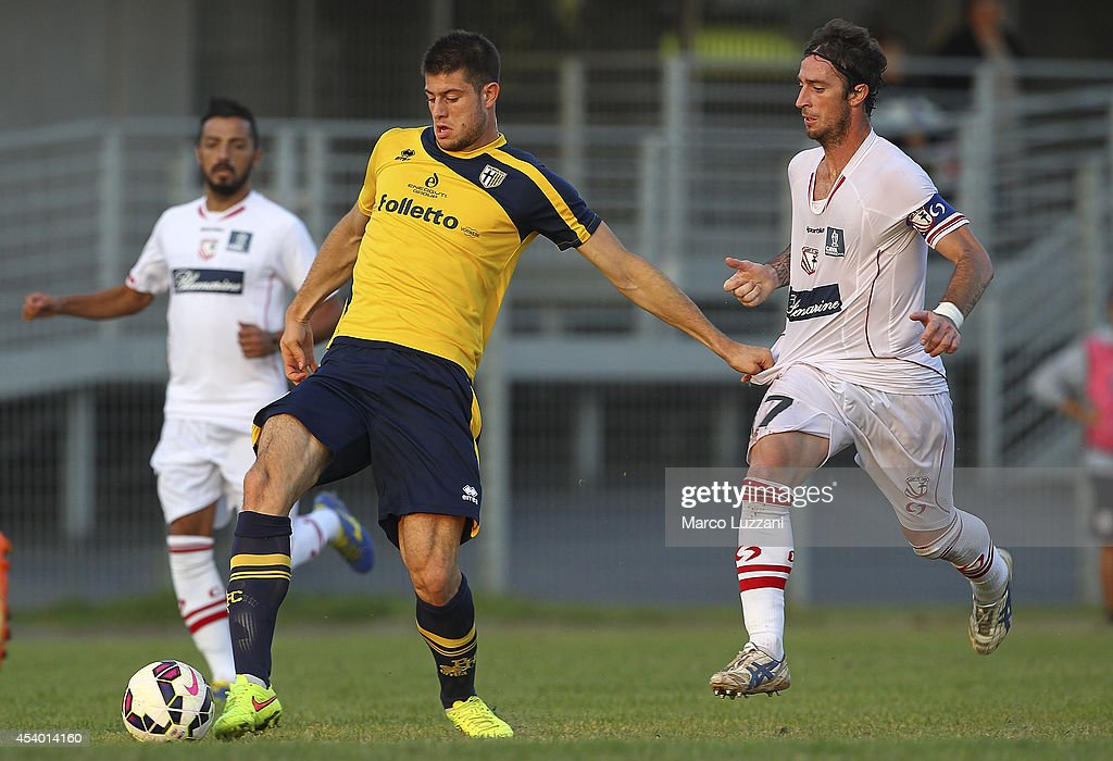 Alberto Cerri of Parma is challenged by Filippo Porcari of Carpi FC during the pre-season friendly match between Carpi FC and FC Parma at Stadio Sandro Cabassi on August 23, 2014 in Carpi, Italy.