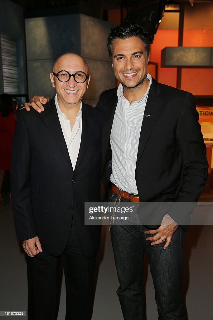 Alberto Ciurana and <a gi-track='captionPersonalityLinkClicked' href=/galleries/search?phrase=Jaime+Camil&family=editorial&specificpeople=580441 ng-click='$event.stopPropagation()'>Jaime Camil</a> are seen on the set of Univision's 'Despierta America' morning show at Univision Headquarters on September 23, 2013 in Miami, Florida.
