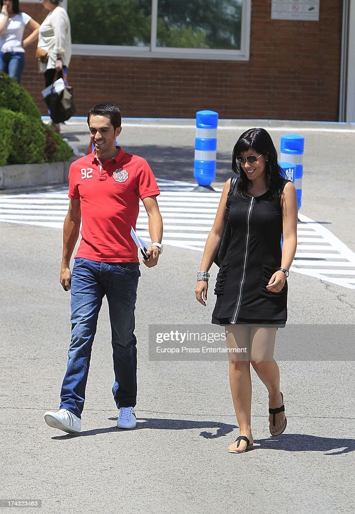 Alberto Contador and his wife Macarena Pescador arrive at Ruber International hospital on July 23, 2013 in Madrid, Spain.