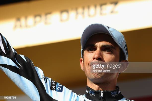 Alberto Contador of Spain and Saxo Bank Sungard looks disappointed after receiving the performance of the day award but heads into the final two...