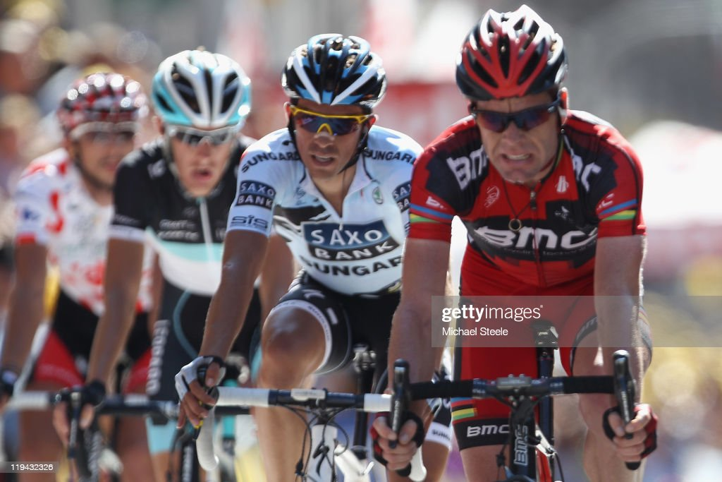 <a gi-track='captionPersonalityLinkClicked' href=/galleries/search?phrase=Alberto+Contador&family=editorial&specificpeople=562697 ng-click='$event.stopPropagation()'>Alberto Contador</a> (2R) of Spain and Saxo Bank Sungard shadows <a gi-track='captionPersonalityLinkClicked' href=/galleries/search?phrase=Cadel+Evans&family=editorial&specificpeople=661127 ng-click='$event.stopPropagation()'>Cadel Evans</a> (R) of Australia and BMC Racing Team across the finishing line alongside <a gi-track='captionPersonalityLinkClicked' href=/galleries/search?phrase=Andy+Schleck&family=editorial&specificpeople=768445 ng-click='$event.stopPropagation()'>Andy Schleck</a> (2L) of Luxemburg and Team Leopard-Trek and Jelle Vanendert (L) of Belgium and Omega Pharma-Lotto during Stage 17 of the 2011 Tour de France from Gap to Pinerolo on July 20, 2011 in Pinerolo, Italy.
