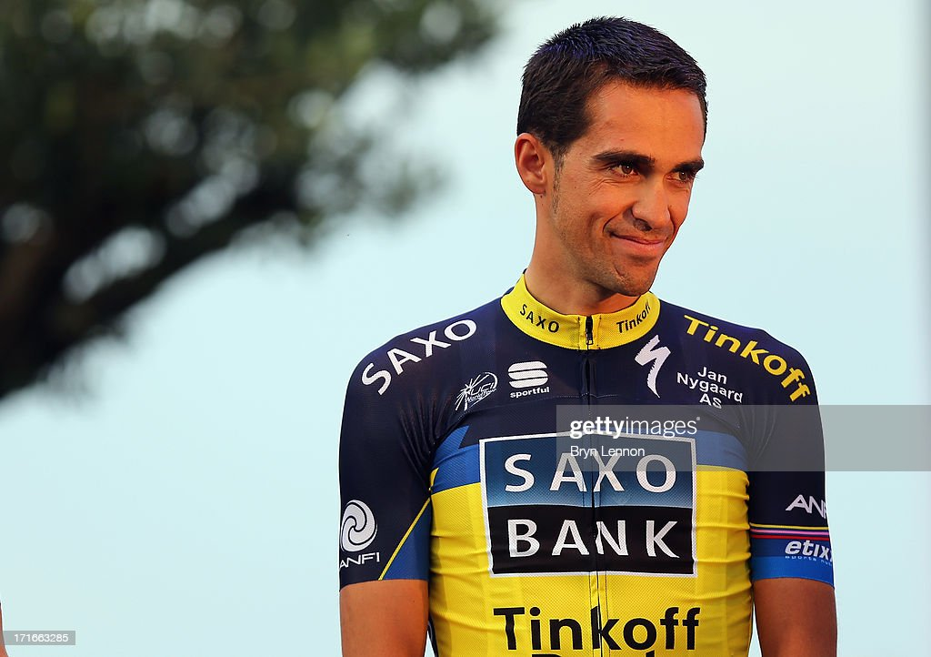 <a gi-track='captionPersonalityLinkClicked' href=/galleries/search?phrase=Alberto+Contador&family=editorial&specificpeople=562697 ng-click='$event.stopPropagation()'>Alberto Contador</a> of Spain and Team Saxo-Tinkoff attends the Team Presentation on June 27, 2013 in Port-Vecchio, Corsica.