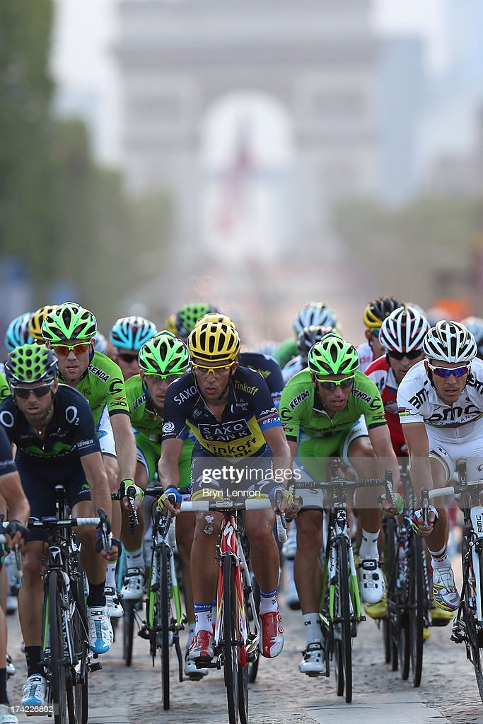 Alberto Contador of Spain and Team Saxo-Tinkoff in action during the twenty first and final stage of the 2013 Tour de France, a processional 133.5KM road stage ending in an evening race around the Champs-Elysees, on July 21, 2013 in Paris, France.