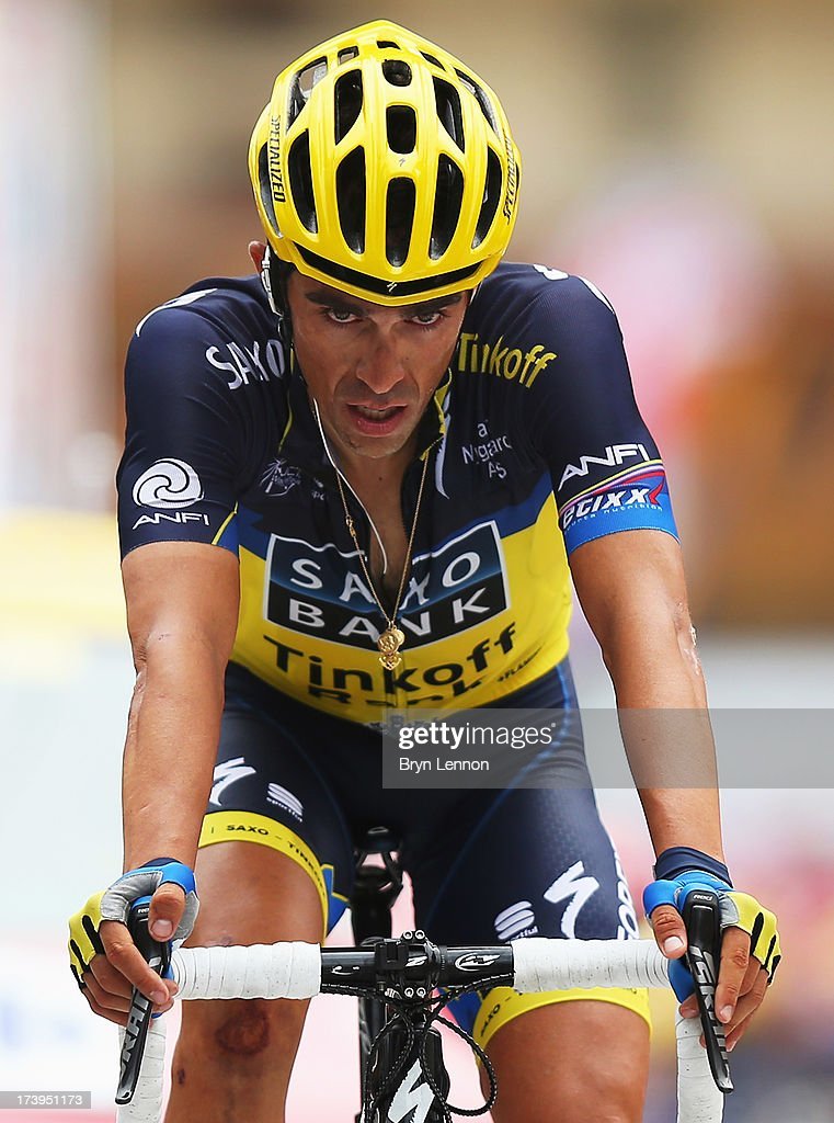 Alberto Contador of Spain and Team SaxoTinkoff reacts as he crosses the finish line at the end of stage eighteen of the 2013 Tour de France a 1725KM...