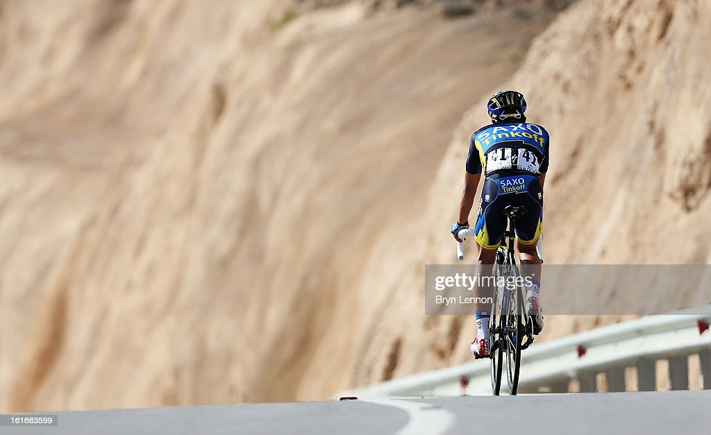 Alberto Contador of Spain and Team Saxo-Tinkoff rides back down the mountain after stage four of the 2013 Tour of Oman from Al Saltiyah in Samail to Jabal Al Akhdhar (Green Mountain) on February 14, 2013 in Jabal Al Akhdhar, Oman.