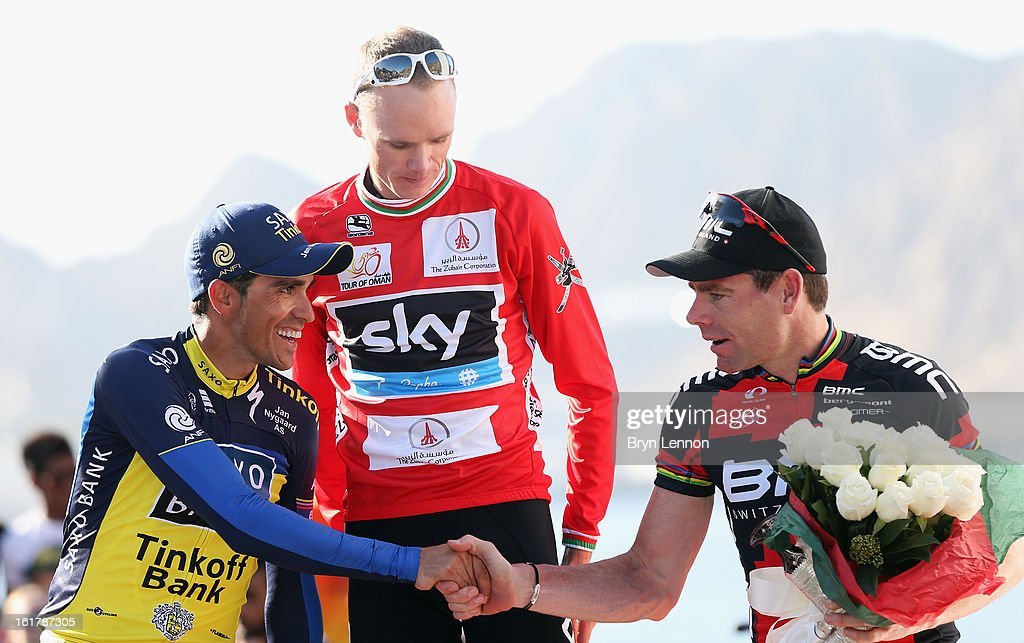 Alberto Contador (2nd) of Spain and Team Saxo-Tinkoff shakes hands with Cadel Evans (3rd) of Australia and the BMC Racing Team after stage six of the 2013 Tour of Oman from Hawit Nagam Park to the Matrah Corniche on February 16, 2013 in Matrah, Oman.