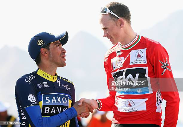 Alberto Contador of Spain and Team SaxoTinkoff shakes hands with race winner Chris Froome of Great Britain and SKY Procycling on the podium after...