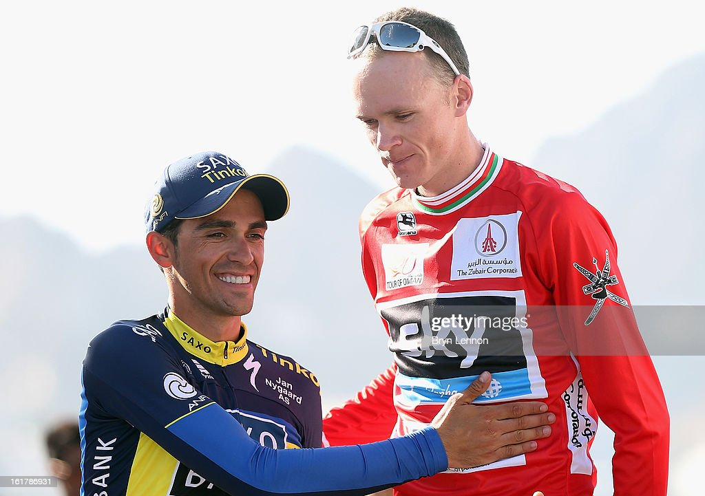 Alberto Contador of Spain and Team Saxo-Tinkoff shakes hands with race winner Chris Froome of Great Britain and SKY Procycling on the podium after stage six of the 2013 Tour of Oman from Hawit Nagam Park to the Matrah Corniche on February 16, 2013 in Matrah, Oman.