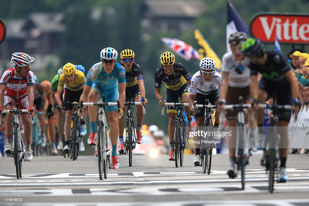 Alberto Contador of Spain and Team Saxo-Tinkoff (C) sprints for the finish line during stage nineteen of the 2013 Tour de France, a 204.5KM road stage from Bourg d'Oisans to Le Grand Bornand, on July 19, 2013 in Le Grand Bornand, France.