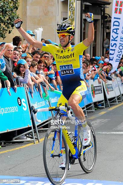 Alberto Contador of Spain and Team TinkoffSaxo smiles on the podiuem after winning the Stage One of Vuelta al pais Vasco 2014 on April 7 2014 in...
