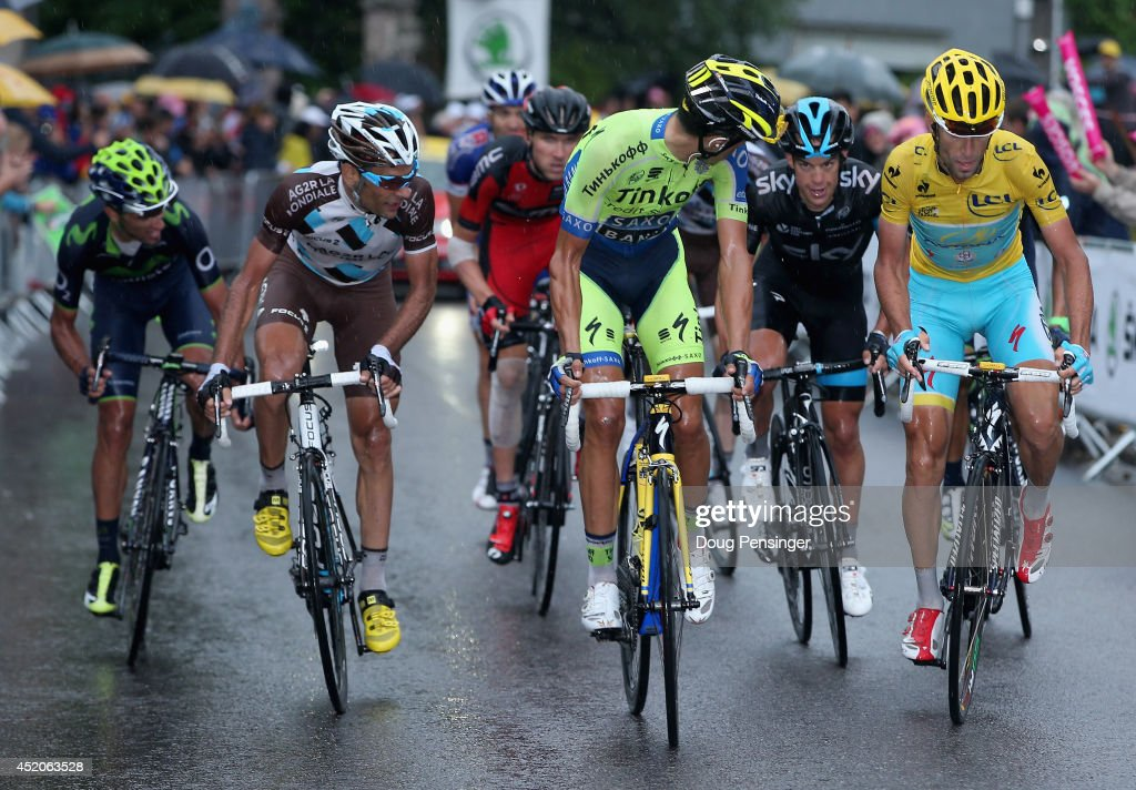 <a gi-track='captionPersonalityLinkClicked' href=/galleries/search?phrase=Alberto+Contador&family=editorial&specificpeople=562697 ng-click='$event.stopPropagation()'>Alberto Contador</a> (C) of Spain and Tinkoff-Saxo attacks the group of the yellow jersey of <a gi-track='captionPersonalityLinkClicked' href=/galleries/search?phrase=Vincenzo+Nibali&family=editorial&specificpeople=770634 ng-click='$event.stopPropagation()'>Vincenzo Nibali</a> (R) of Italy and the Astana Pro Team on the final climb of stage eight of the 2014 Le Tour de France from Tomblaine to Gerardmer La Mauselaine on July 12, 2014 in Gerardmer La Mauselaine, France. Included in the group is John Gadret of France and the Movistar Team, <a gi-track='captionPersonalityLinkClicked' href=/galleries/search?phrase=Jean-Christophe+Peraud&family=editorial&specificpeople=777897 ng-click='$event.stopPropagation()'>Jean-Christophe Peraud</a> of France and AG2R La Mondiale, Tejay van Garderen of the United States and the BMC Racing Team and <a gi-track='captionPersonalityLinkClicked' href=/galleries/search?phrase=Richie+Porte&family=editorial&specificpeople=4836819 ng-click='$event.stopPropagation()'>Richie Porte</a> of Australia.