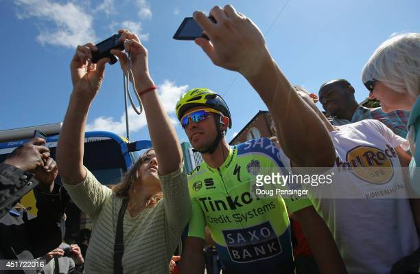 Alberto Contador of Spain and TinkoffSaxo pauses for a photo with fans prior to the start of stage one of the 2014 Tour de France from Leeds to...