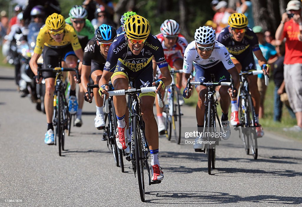 <a gi-track='captionPersonalityLinkClicked' href=/galleries/search?phrase=Alberto+Contador&family=editorial&specificpeople=562697 ng-click='$event.stopPropagation()'>Alberto Contador</a> of Spain riding for Team Saxo-Tinkoff attacks the group of the yellow jersey of <a gi-track='captionPersonalityLinkClicked' href=/galleries/search?phrase=Chris+Froome&family=editorial&specificpeople=5428054 ng-click='$event.stopPropagation()'>Chris Froome</a> (L) of Great Britain riding for Sky Procycling on the Col de Manse during stage sixteen of the 2013 Tour de France, a 168KM road stage from Vaison-la-Romaine to Gap, on July 16, 2013 in Gap, France. Froome defended the yellow jersey during the stage.