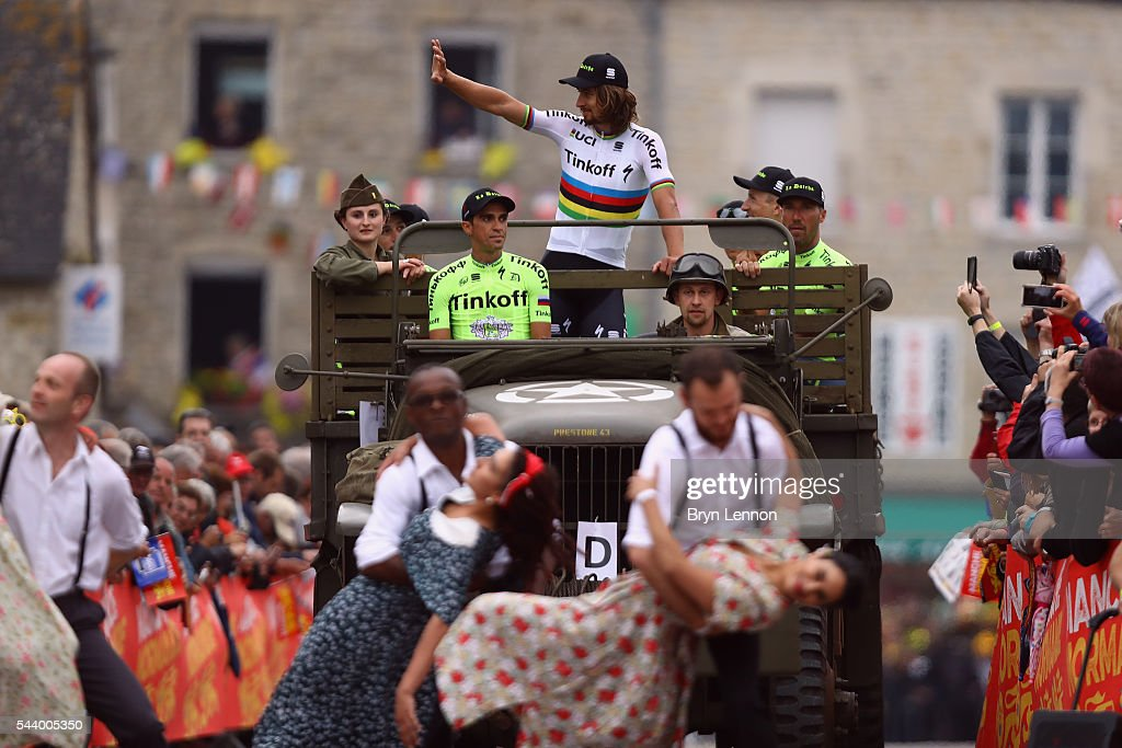 <a gi-track='captionPersonalityLinkClicked' href=/galleries/search?phrase=Alberto+Contador&family=editorial&specificpeople=562697 ng-click='$event.stopPropagation()'>Alberto Contador</a> (l) of Spain Tinkoff and team mate <a gi-track='captionPersonalityLinkClicked' href=/galleries/search?phrase=Peter+Sagan&family=editorial&specificpeople=4846179 ng-click='$event.stopPropagation()'>Peter Sagan</a> (c) of Slovakia attend the Team Presentation ahead of the 2016 Tour de France at on June 30, 2016 in Sainte-Mere-Eglise, France.