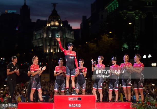 Alberto Contador waves with members of his Trek team after Stage 21 of the Vuelta a Espana race on September 10 2017 in Madrid Spain