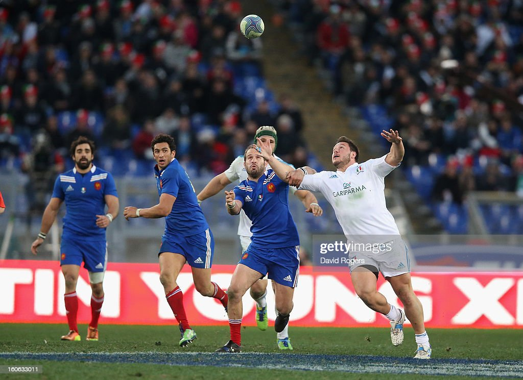 Alberto de Marchi (R) of Italy beats Frederick Michalak to the loose ball during the RBS Six Nations match between Italy and France at Stadio Olimpico on February 3, 2013 in Rome, Italy.