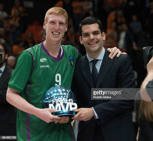 Alberto Diaz #9 of Unicaja Malaga receives from Giannis Theodoropoulos Representative of Chipita brand the MVP of the Final trophuy at the end of the...