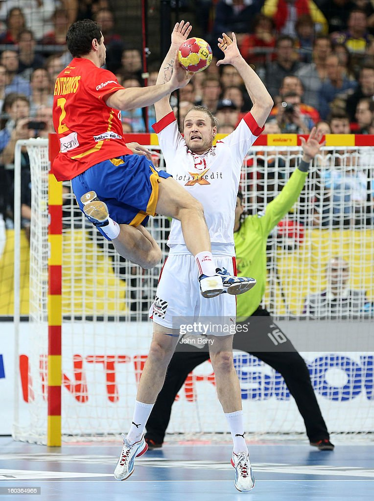 Alberto Entrerr'os of Spain shoots despite Henrik M¿llgaard of Denmark during the Men's Handball World Championship 2013 final match between Spain and Denmark at Palau Sant Jordi on January 27, 2013 in Barcelona, Spain.