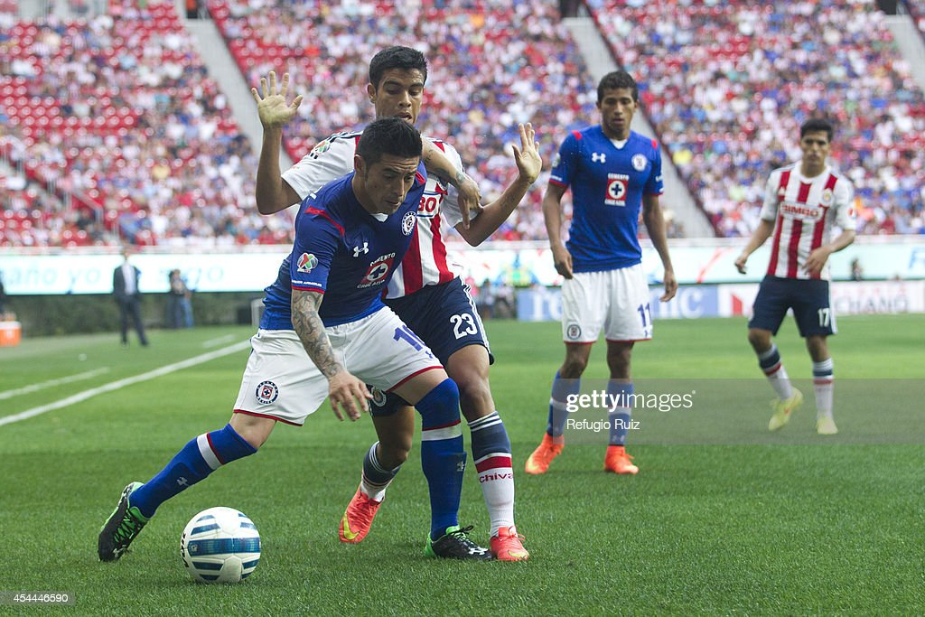 Alberto Garcia of Chivas fights for the ball with Rogelio Chavez of Cruz Azul during a match between Chivas and Cruz Azul a as part of Apertura 2014 Liga MX at Omnilife Stadium on August 31, 2014 in Guadalajara, Mexico.