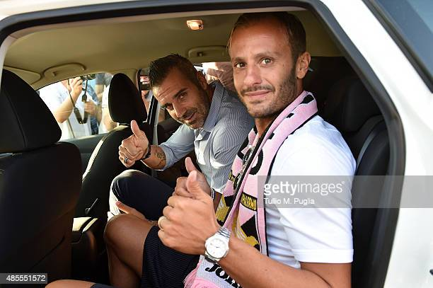 Alberto Gilardino new player of US Citta' di Palermo poses with captain Stefano Sorrentino after arriving at FalconeBorsellino airport on August 28...