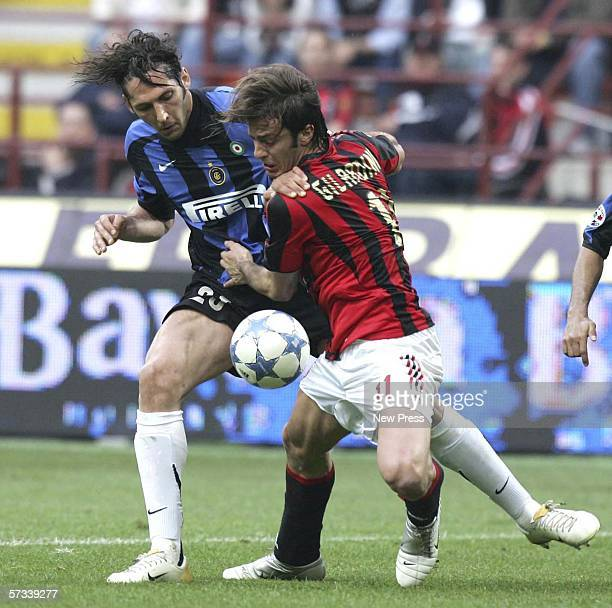 Alberto Gilardino of AC Milan challenges Marco Materazzi of Inter during the Serie A match between AC Milan and Inter Milan at the San Siro on April...