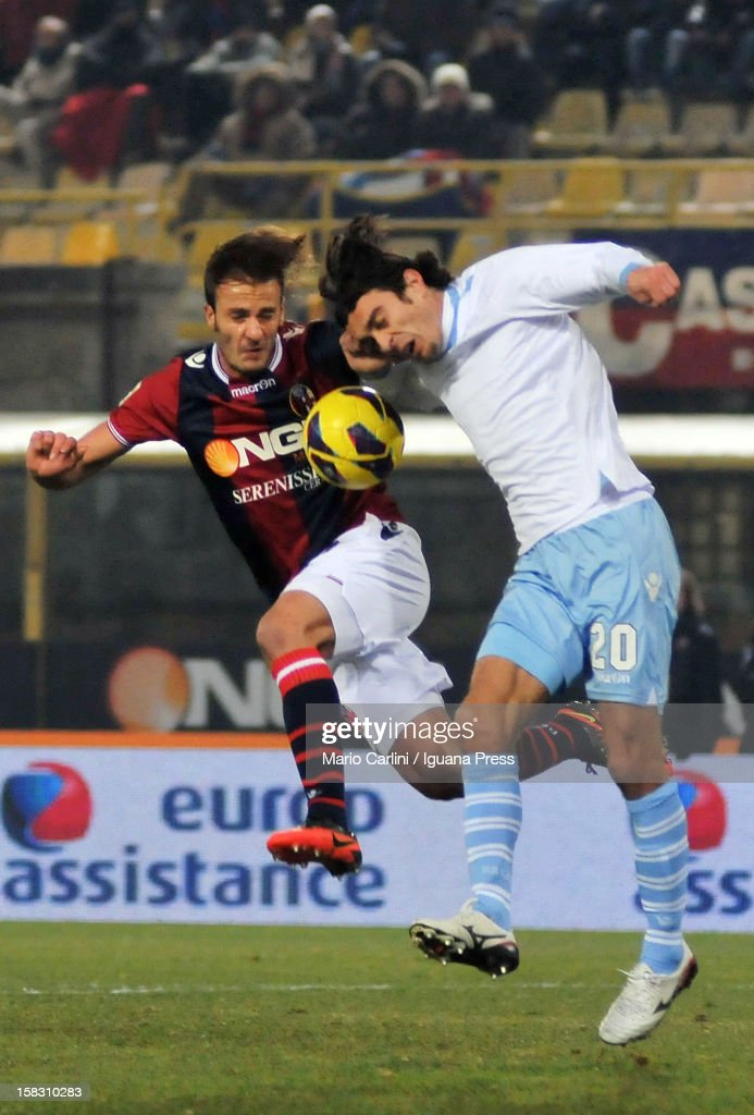 <a gi-track='captionPersonalityLinkClicked' href=/galleries/search?phrase=Alberto+Gilardino&family=editorial&specificpeople=215491 ng-click='$event.stopPropagation()'>Alberto Gilardino</a> (L) of Bologna FC competes for the ball with Giuseppe Biava of SS Lazio during the Serie A match between Bologna FC and S.S. Lazio at Stadio Renato Dall'Ara on December 10, 2012 in Bologna, Italy.
