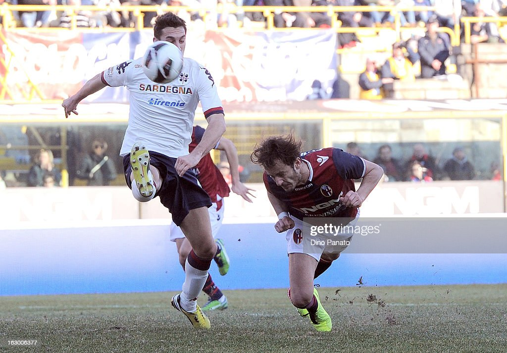 <a gi-track='captionPersonalityLinkClicked' href=/galleries/search?phrase=Alberto+Gilardino&family=editorial&specificpeople=215491 ng-click='$event.stopPropagation()'>Alberto Gilardino</a> (R) of Bologna FC competes with <a gi-track='captionPersonalityLinkClicked' href=/galleries/search?phrase=Davide+Astori&family=editorial&specificpeople=5658888 ng-click='$event.stopPropagation()'>Davide Astori</a> of Cagliari Calcio during the Serie A match between Bologna FC and Cagliari Calcio at Stadio Renato Dall'Ara on March 3, 2013 in Bologna, Italy.