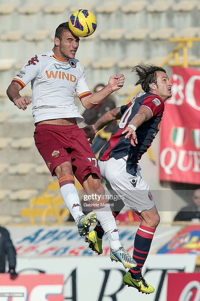 Alberto Gilardino of Bologna FC fights for the ball with Panagiotis Tachtsidis (L) of AS Roma during the Serie A match between Bologna FC and AS Roma at Stadio Renato Dall'Ara on January 27, 2013 in Bologna, Italy.