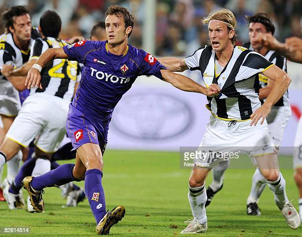 Alberto Gilardino of Fiorentina and Christian Poulsen of Juventus in action during the Serie A match between Fiorentina and Juventus at the Stadio...