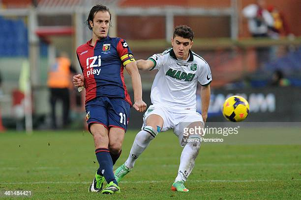 Alberto Gilardino of Genoa CFC is challenged by Luca Antei of US Sassuolo Calcio during the Serie A match between Genoa CFC and US Sassuolo Calcio at...