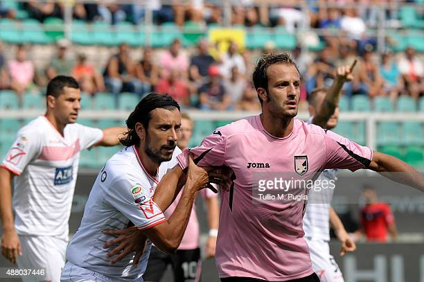 Alberto Gilardino of Palermo is challenged by Cristian Zaccardo of Carpi during the Serie A match between US Citta di Palermo and Carpi FC at Stadio...