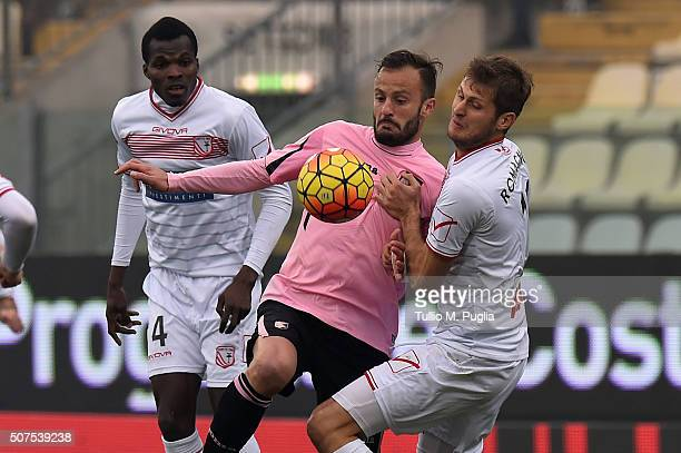 Alberto Gilardino of Palermo is challenged by Jerry Mbakogu and Simone Romagnoli of Carpi during the Serie A match between Carpi FC and US Citta di...