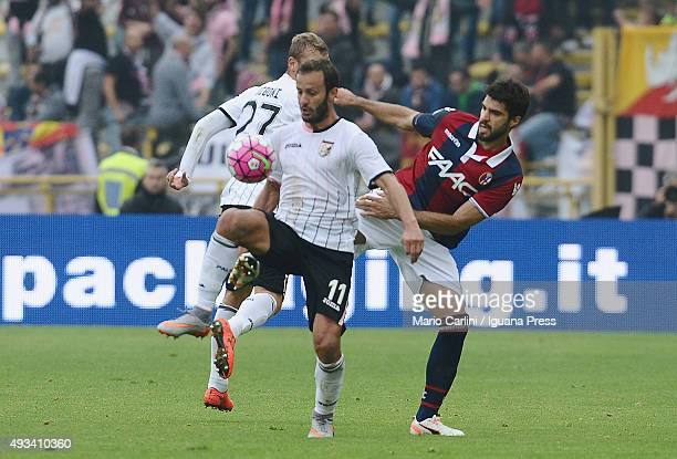 Alberto Gilardino of US Città di Palermo competes the ball with Luca Rossettini of Bologna FC during the Serie A match between Bologna FC and US...