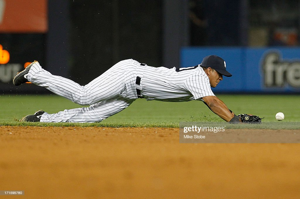 Alberto Gonzalez #40 of the New York Yankees is unabe to catch a single by Mitch Moreland #18 of the Texas Rangers in the sixth inning at Yankee Stadium on June 26, 2013 in the Bronx borough of New York City. Rangers defeated the Yankees 8-5.