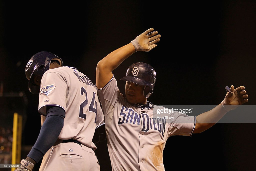 Alberto Gonzalez #14 of the San Diego Padres is congratulated by <a gi-track='captionPersonalityLinkClicked' href=/galleries/search?phrase=Cameron+Maybin&family=editorial&specificpeople=2364846 ng-click='$event.stopPropagation()'>Cameron Maybin</a> #24 after he scored in the ninth inning of their game against the San Francisco Giants at AT&T Park on August 23, 2011 in San Francisco, California.