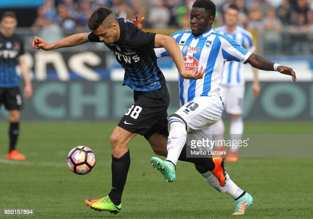Alberto Grassi of Atalanta BC competes for the ball with Sulley Muntari of Pescara Calcio during the Serie A match between Atalanta BC and Pescara...