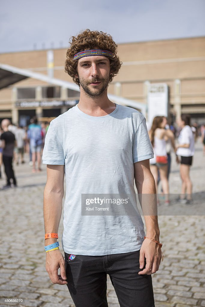 Alberto is wearing t-shirt from Zara and pants from artisan shop at the Sonar Music Festival on June 14, 2014 in Barcelona, Spain.