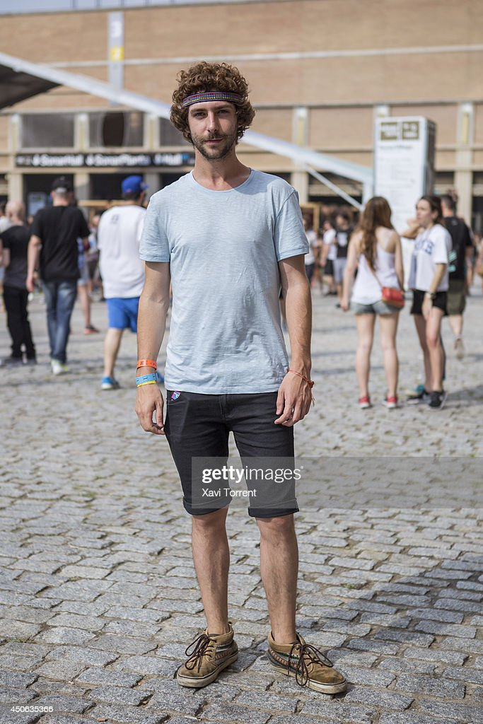 Alberto is wearing t-shirt from Zara, pants from artisan shop, and footwear from Vans at the Sonar Music Festival on June 14, 2014 in Barcelona, Spain.