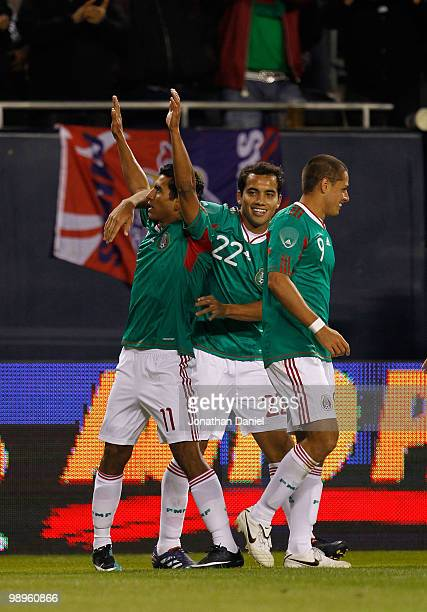 Alberto Medina Adrian Aldrete and Javier Hernandez of Mexico celebrate Medinas' game winning goal against Senegal during an international friendly at...