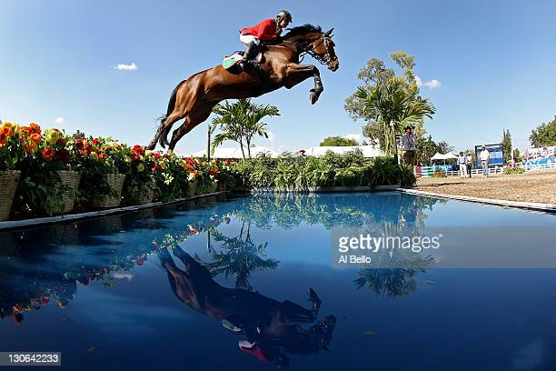 Alberto Michan of Mexico jumps the water during the Jumping Competition at the Guadalajara Country Club on Day 13 of the XVI Pan American Games on...
