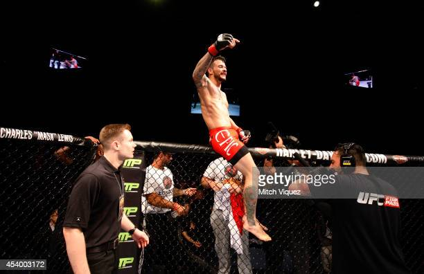 Alberto Mina celebrates his win over Shinsho Anzai in their welterweight fight during the UFC Fight Night event at the Venetian Macau on August 23...